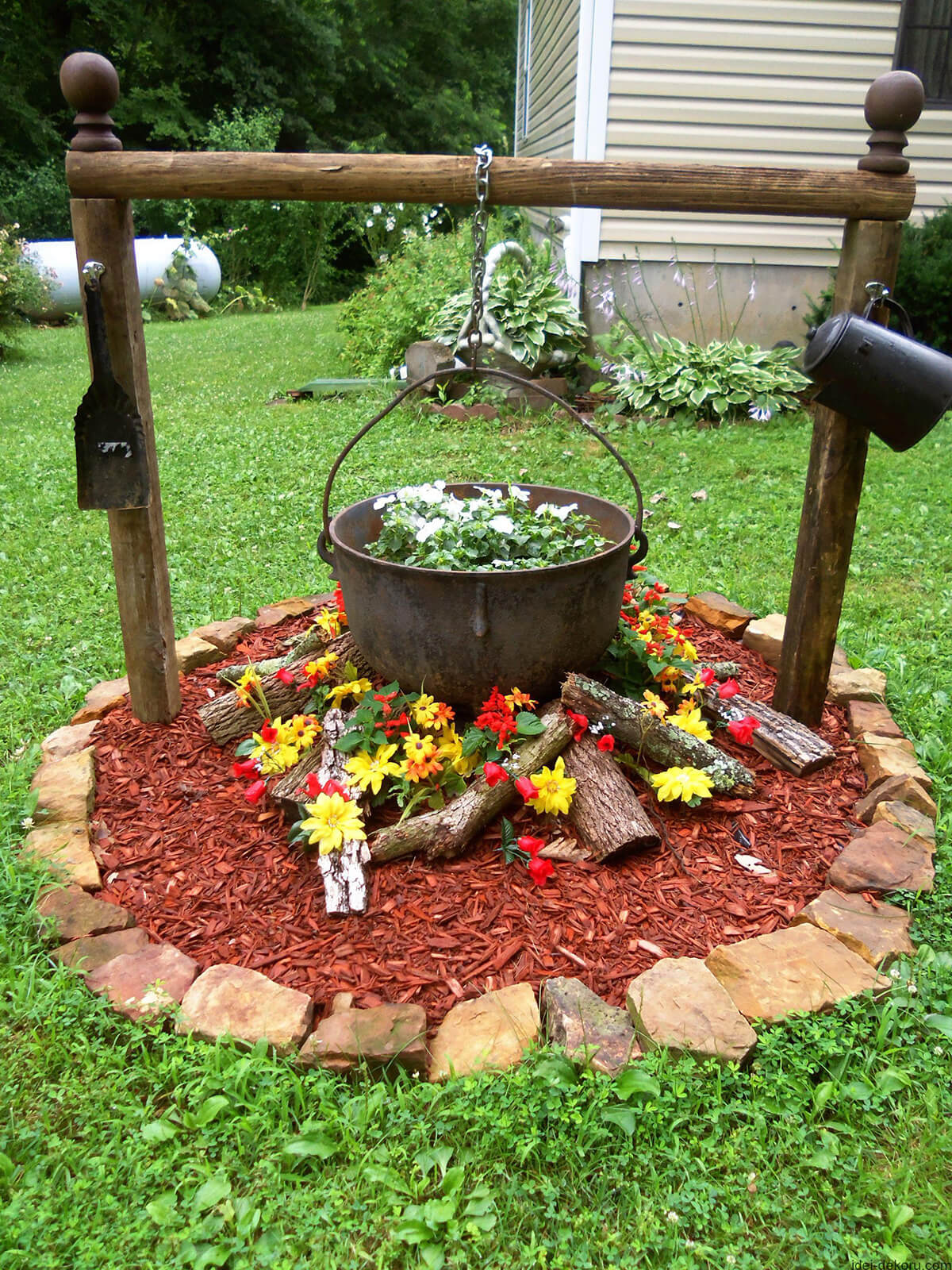 Captivating Antique Cauldron Flower Bed Design