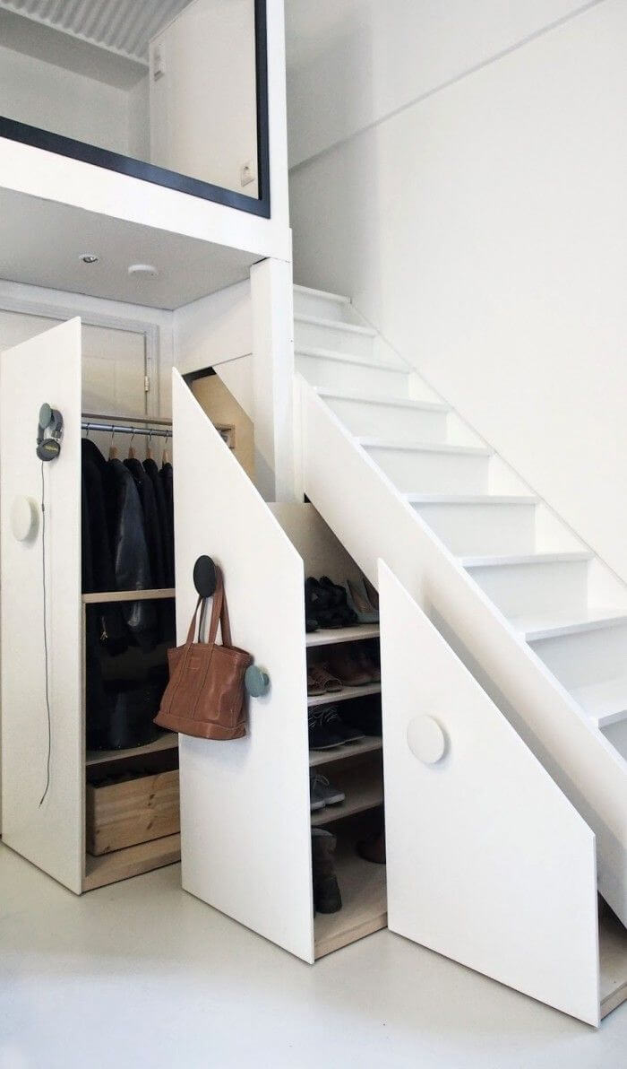 Secret Clothing Closet Beneath a Stairway