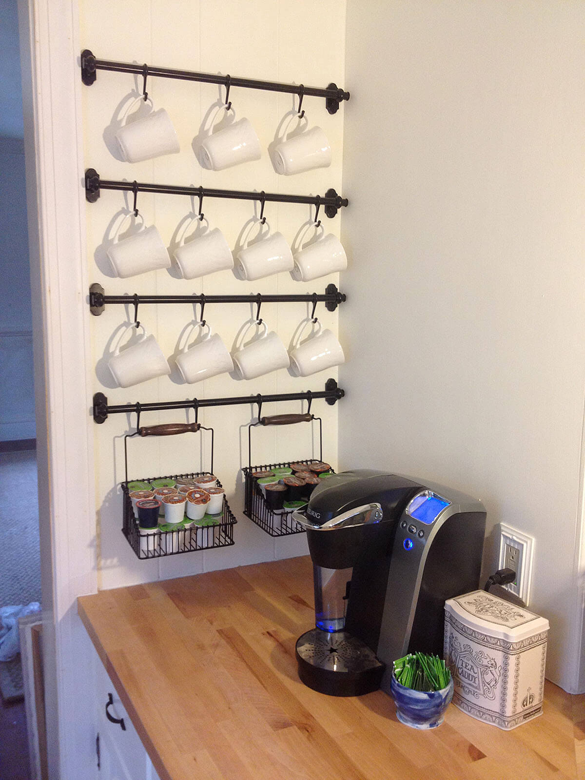 Wall-mounted Pipes with Mug Hooks and Storage Caddies