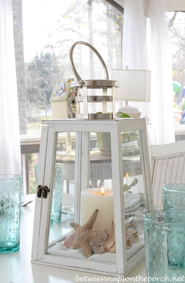 10. Soft Sandy Beach Centerpiece with Lighthouse Inspirations