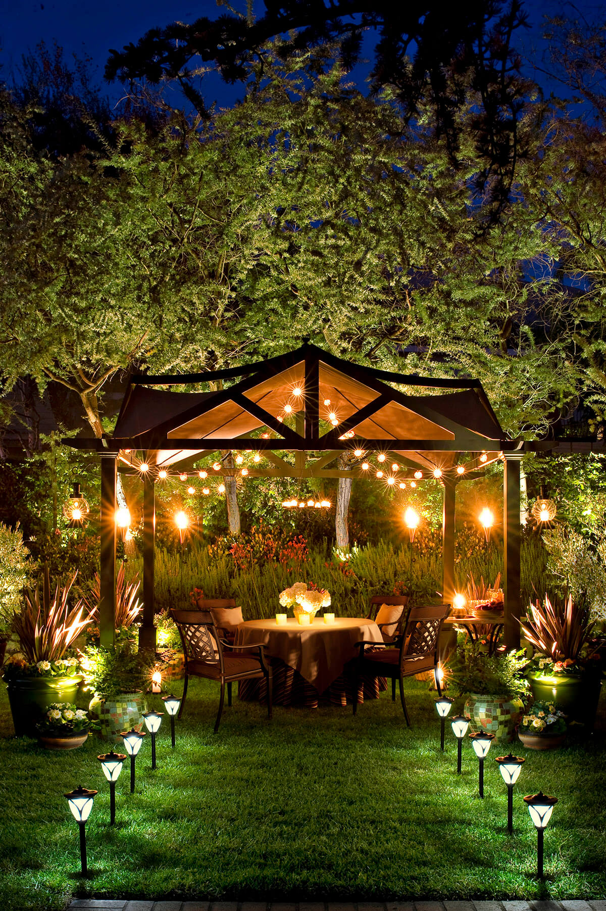 Elegant Well Lit Backyard Dinner Party Pergola