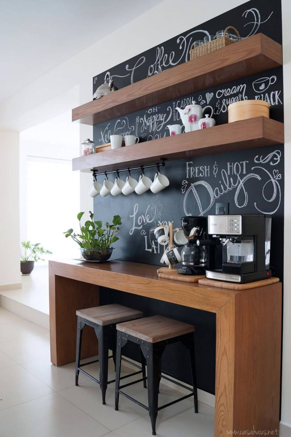 Modern Floating Shelf Storage with Chalkboard Backdrop