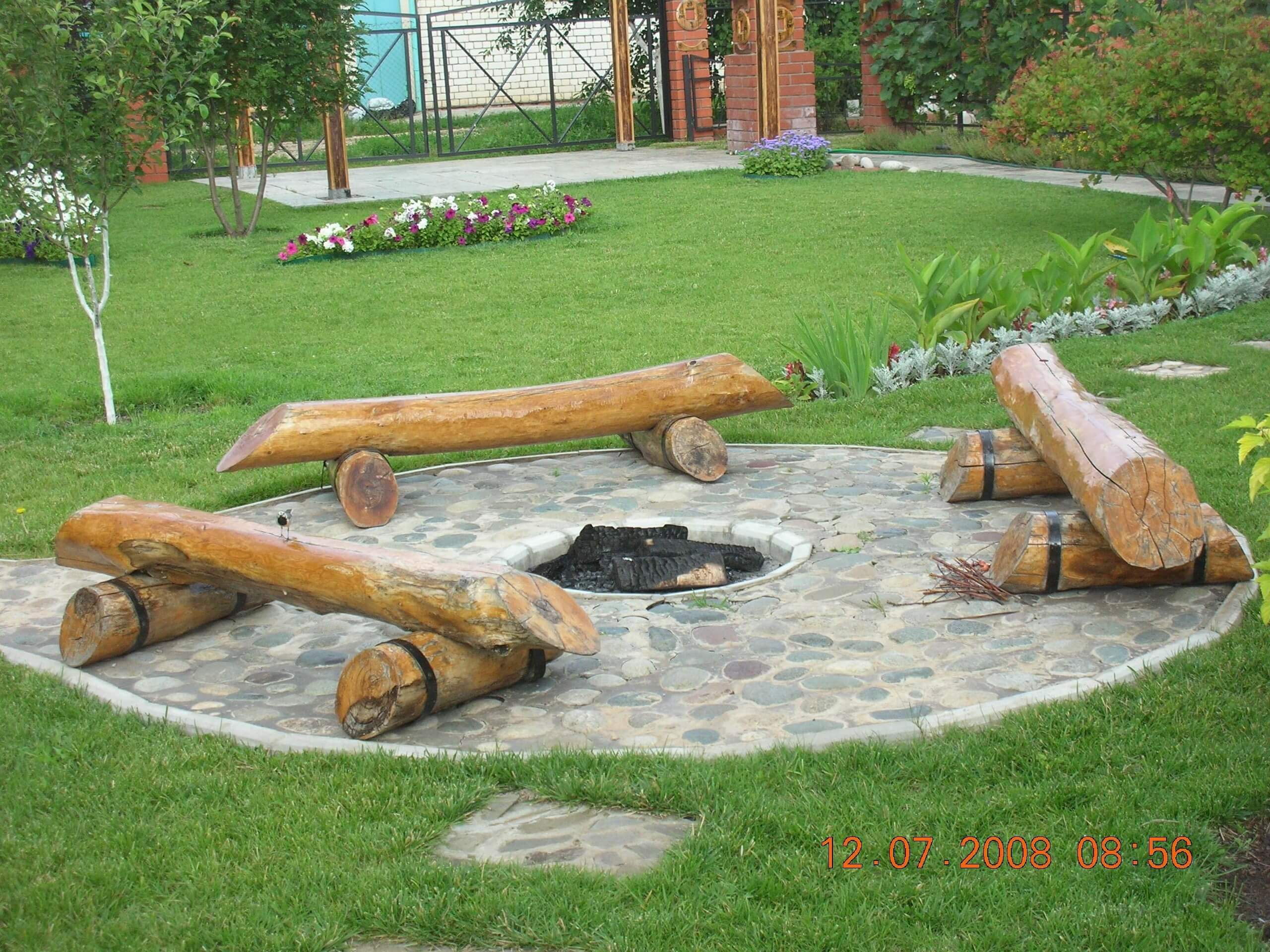 Log Benches Surrounding a Pit in Stone