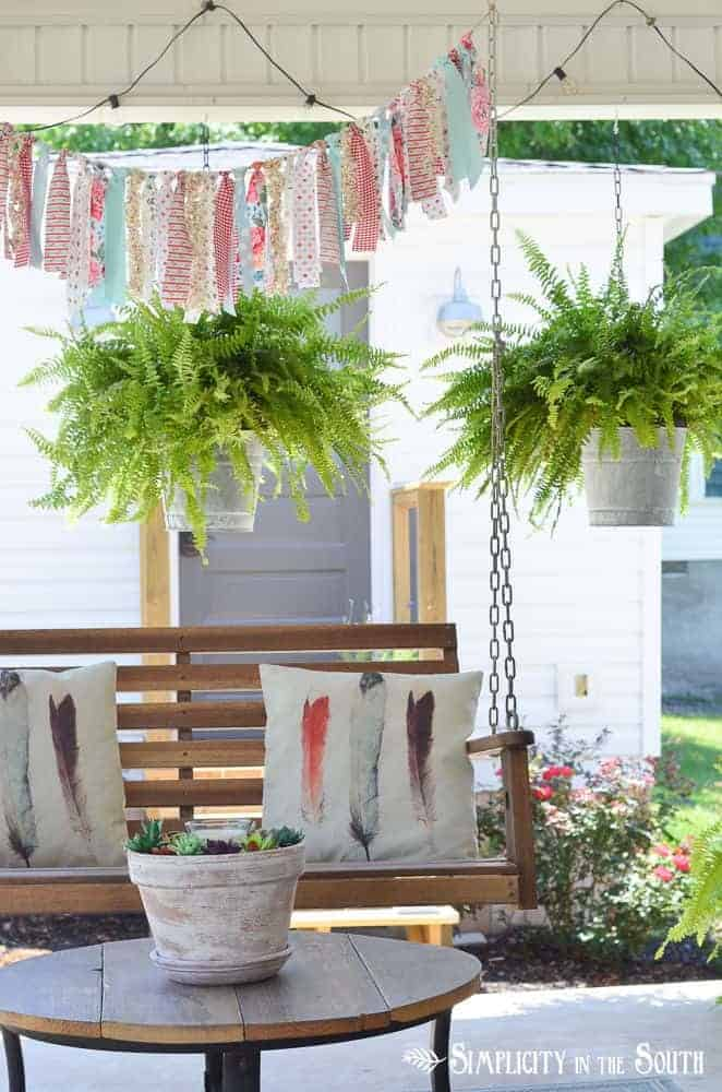 Overhead Overload with Lights, Ferns, and Fabric Garland