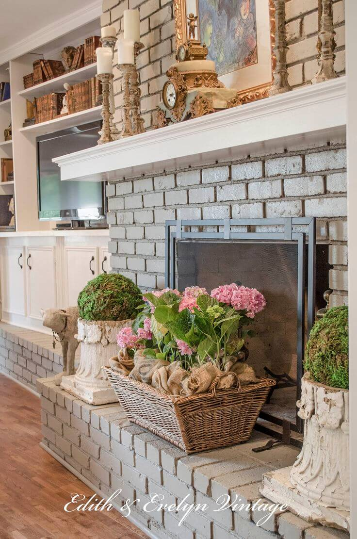 Grey Brick Fireplace with Potted Spring Flowers
