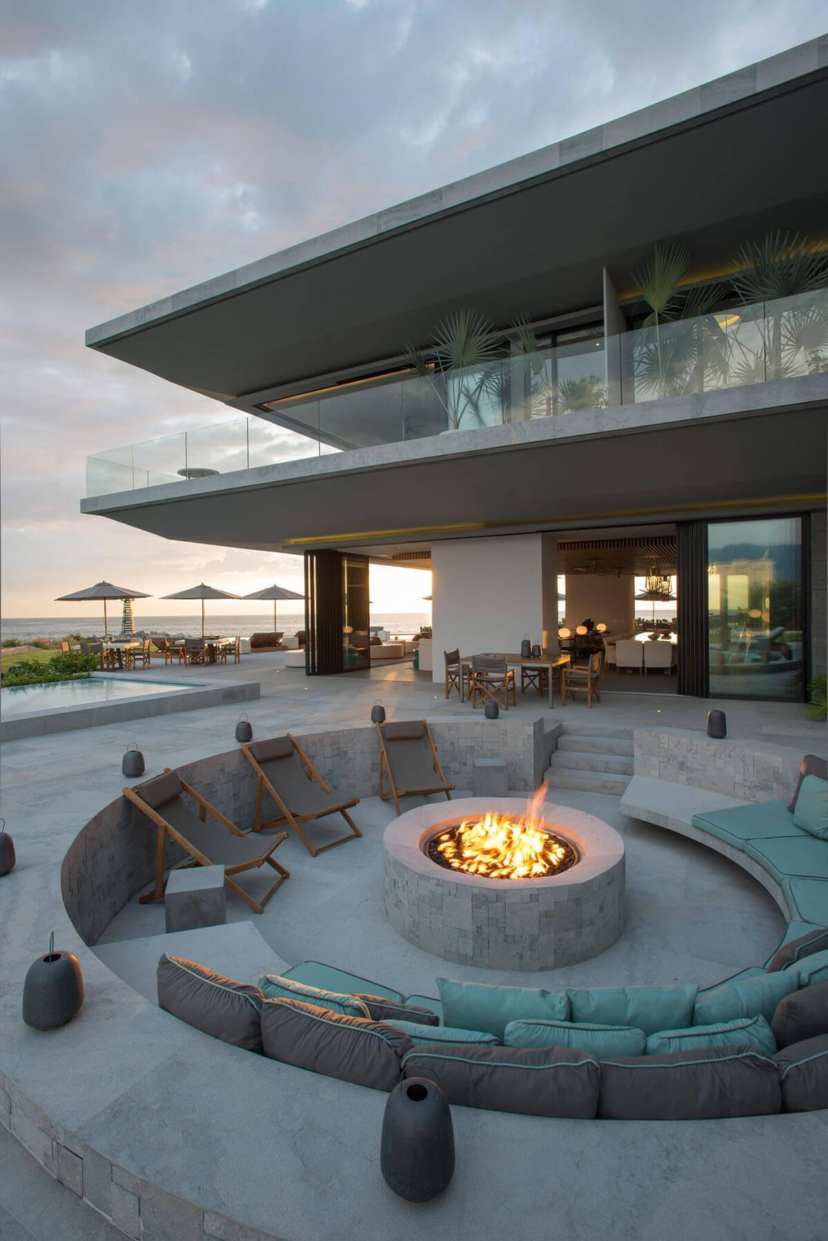 A Sunken Concrete Firepit with Comfortable Seating