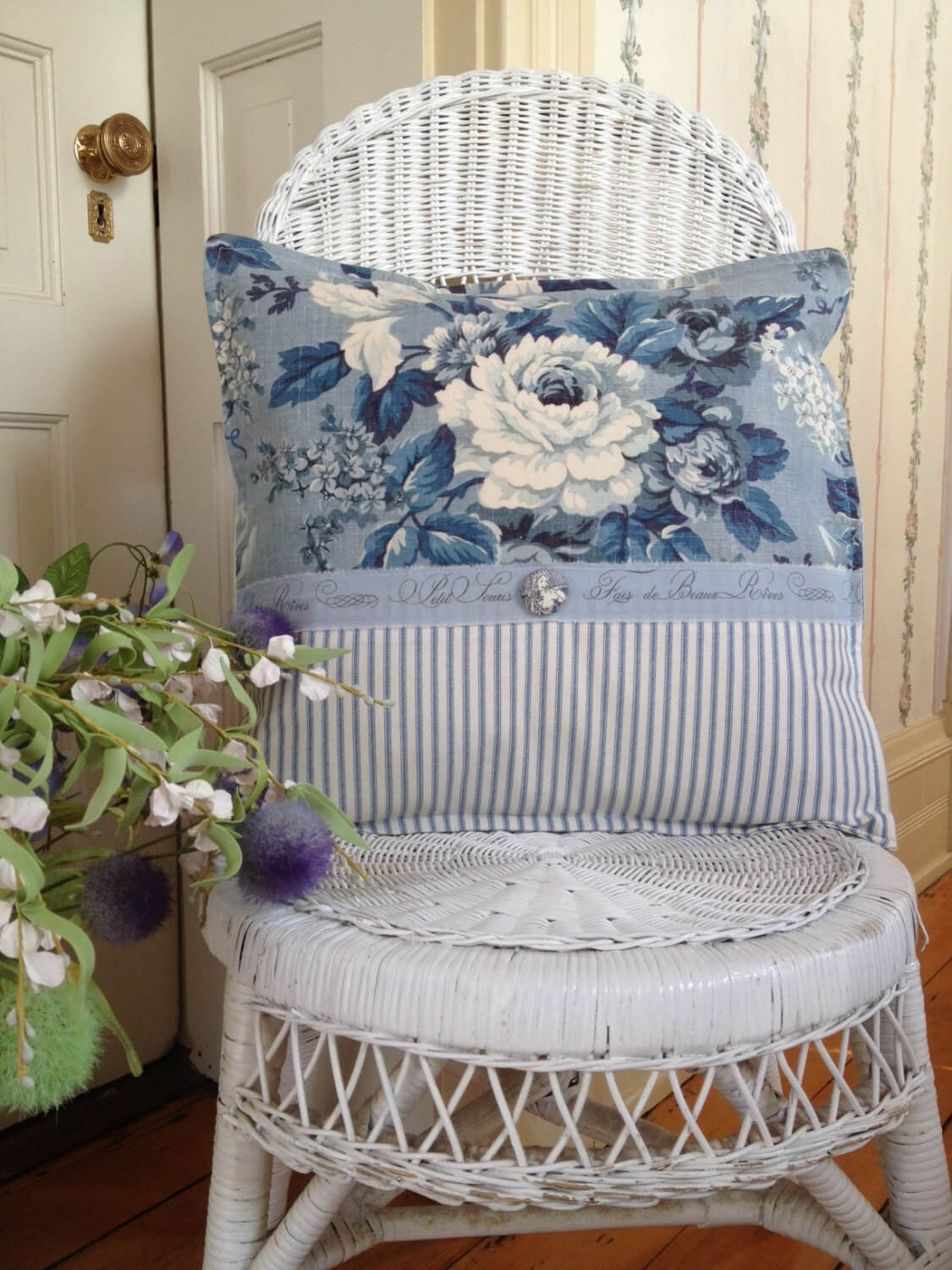 White Wicker Chair with Blue Toile Pillow