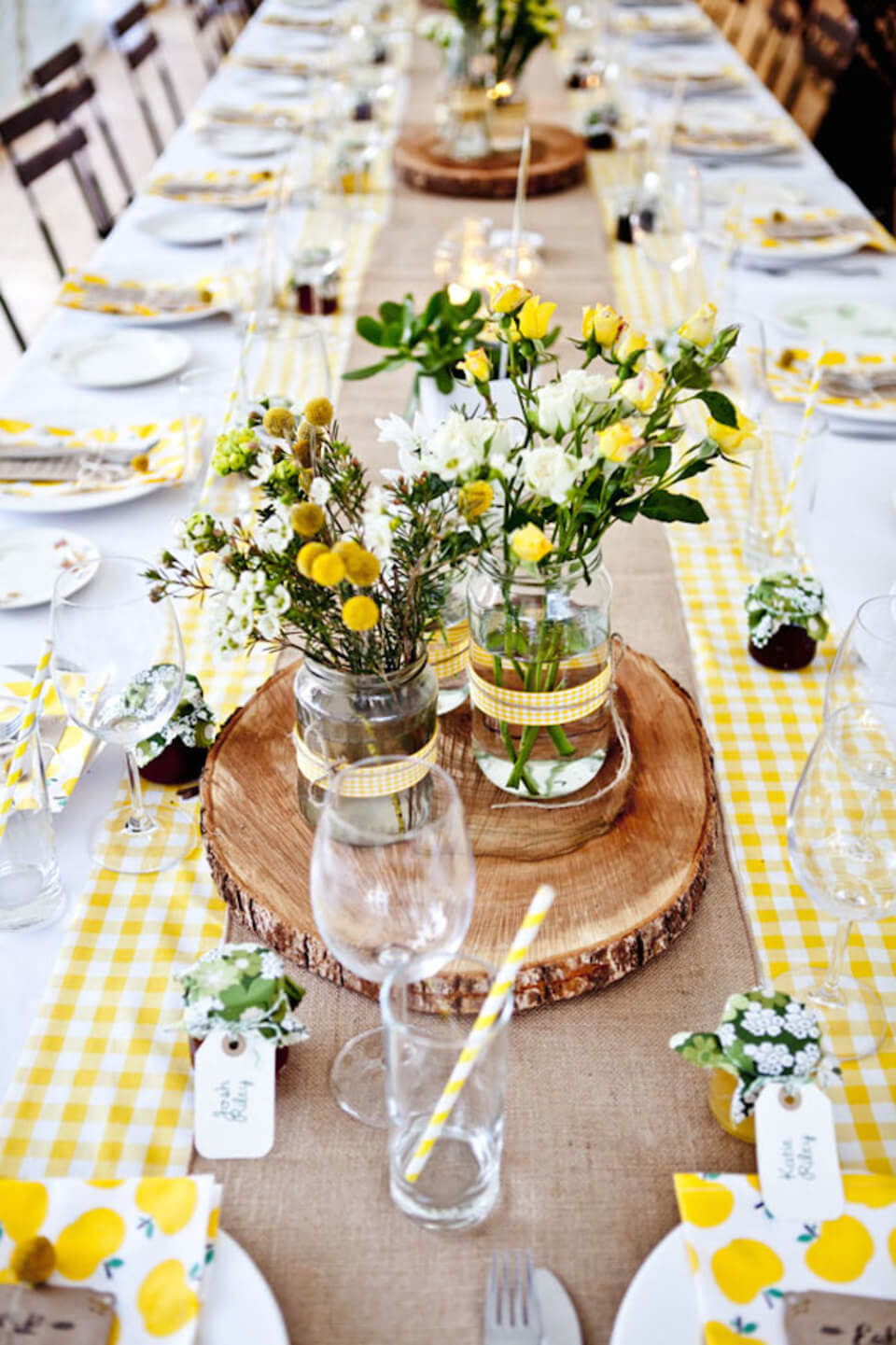 Cheerful Meadow-Themed Table Decor with Wooden Stump Plates