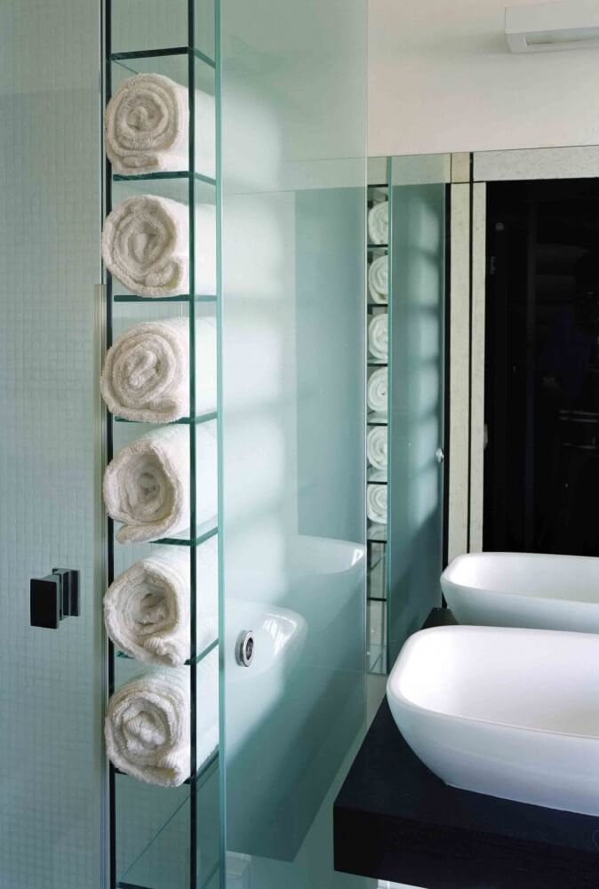 A wine rack in the bathroom is a clever way to keep a few towels right at hand. It's a perfect solution for a guest bathroom, so friends don't need to hunt down a clean hand towel. Simply roll up towels and place bath towels on top and smaller hand towels and washcloths in the spaces below.
