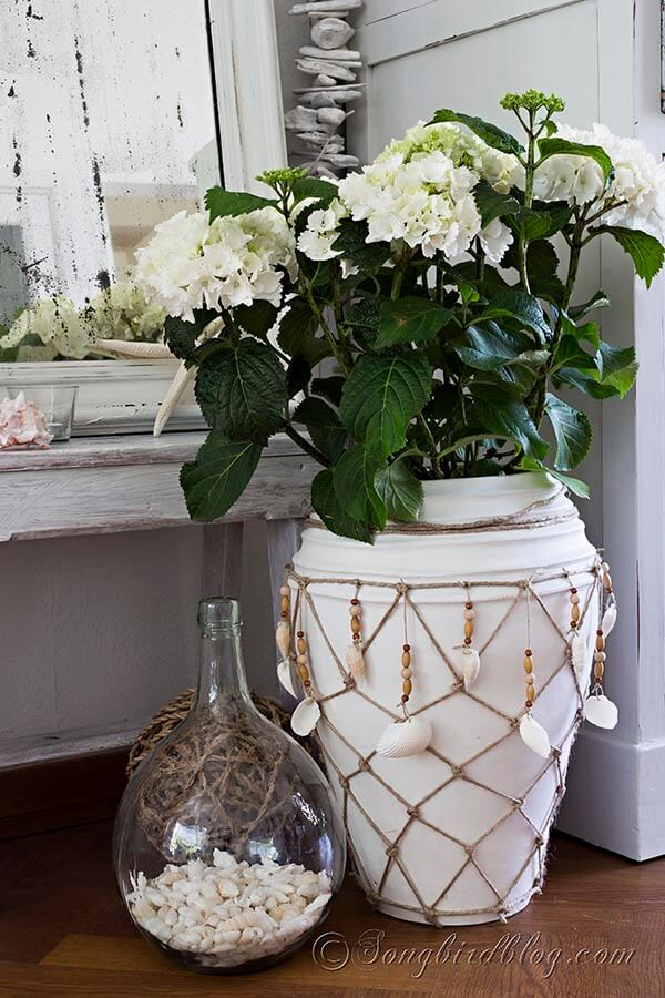 A Decorative Planter Rope with Dangling Shells
