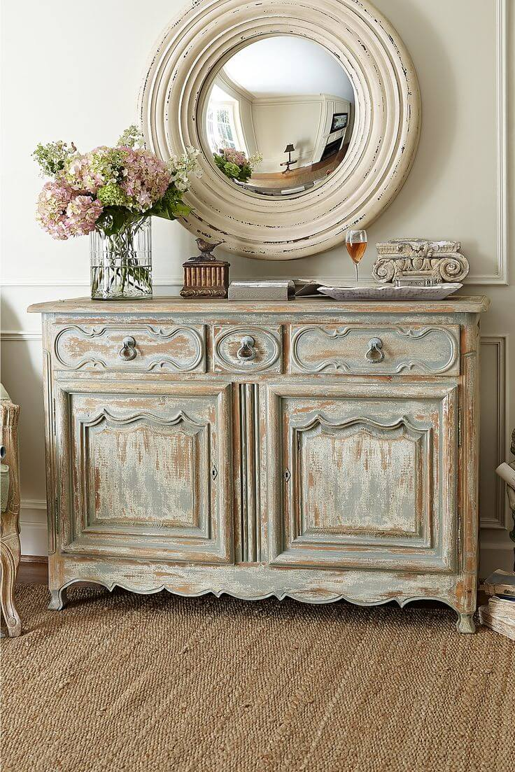 Antiqued Credenza and Rustic Round Mirror