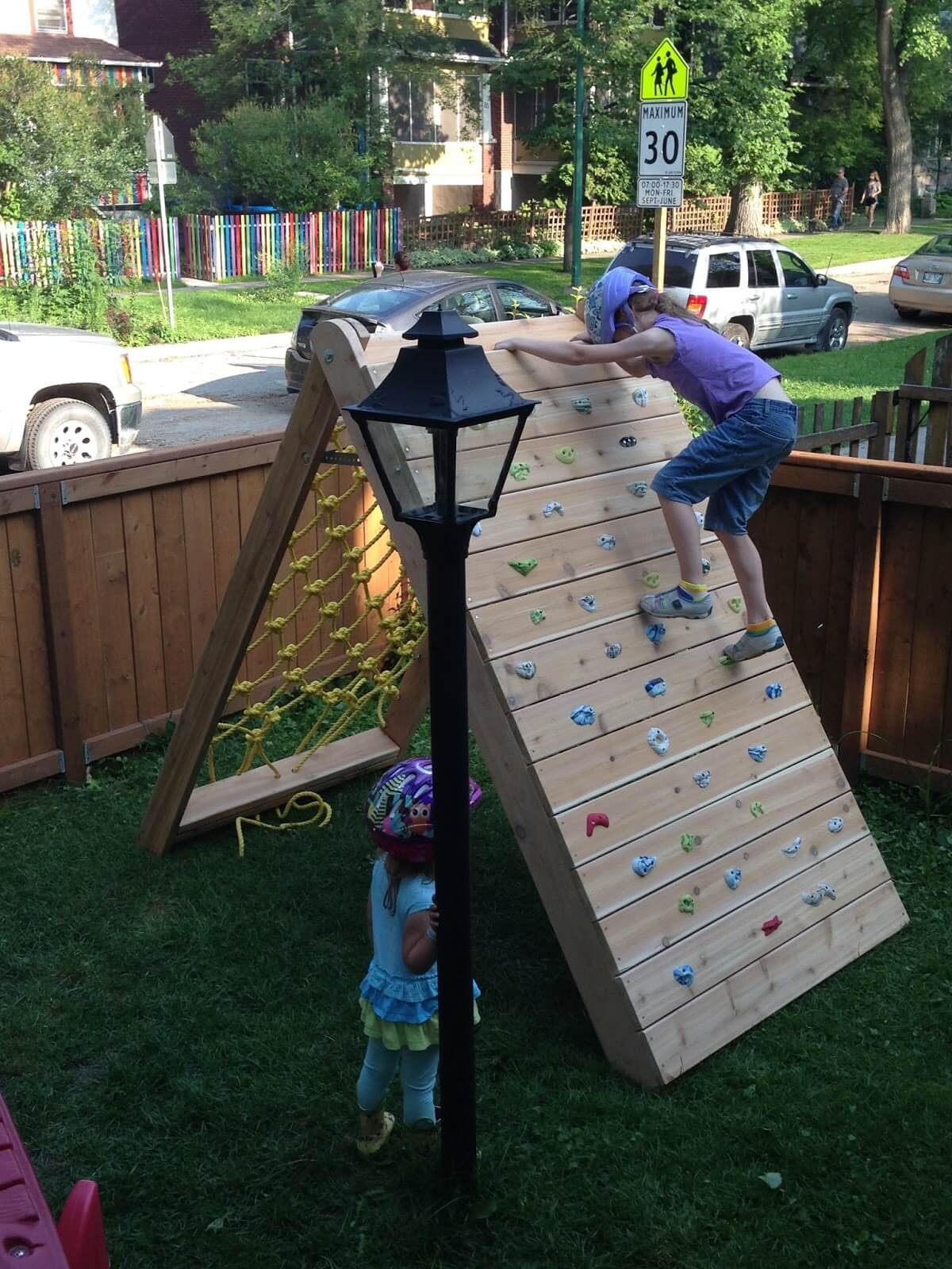 3. Rock Wall and Cargo Net Obstacle Course - 34 Best DIY Backyard Ideas And Designs For Kids In 2019