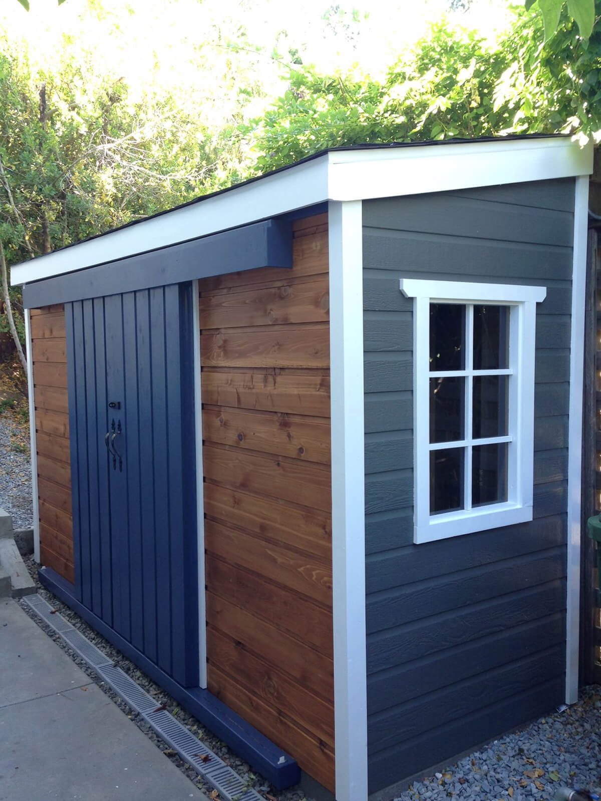 a small black and tan storage unit - Garden Sheds Small