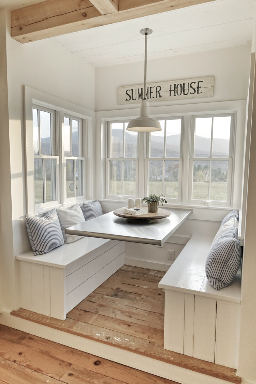 11 a cozy breakfast nook made from wood - Beach House Interior Design Ideas