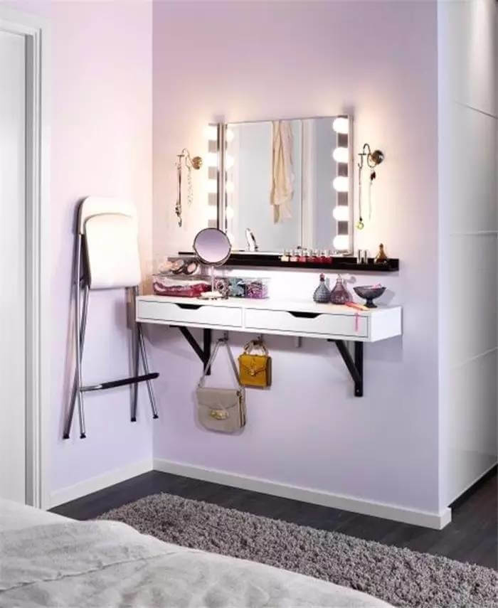 A Vanity With Hooks, Drawers, And Lighting