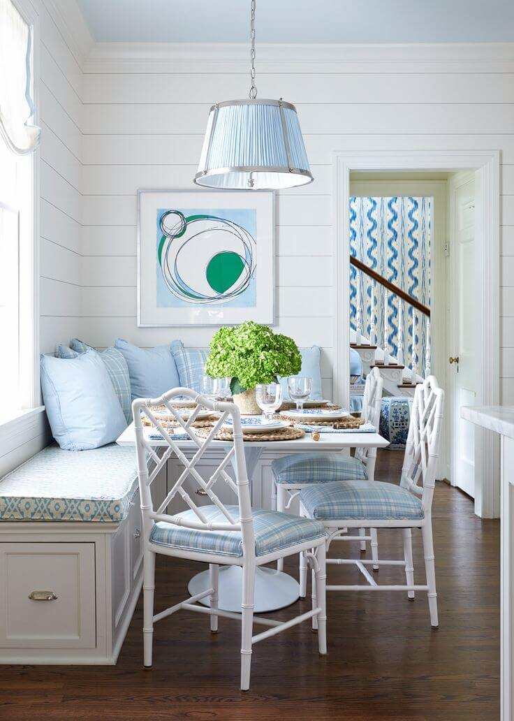26. A Breakfast Nook With Soft Blue Cushions