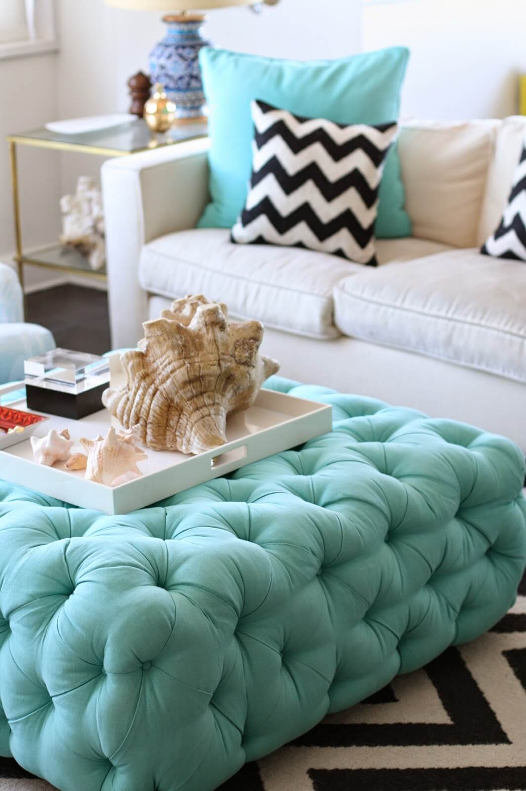 Turquoise Ottoman in a Shell-Inspired Living Area