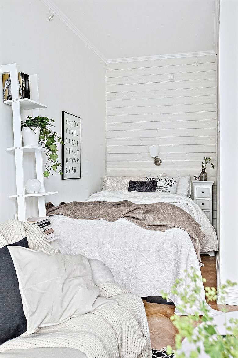 32. Welcoming White Shelves And Green Plants