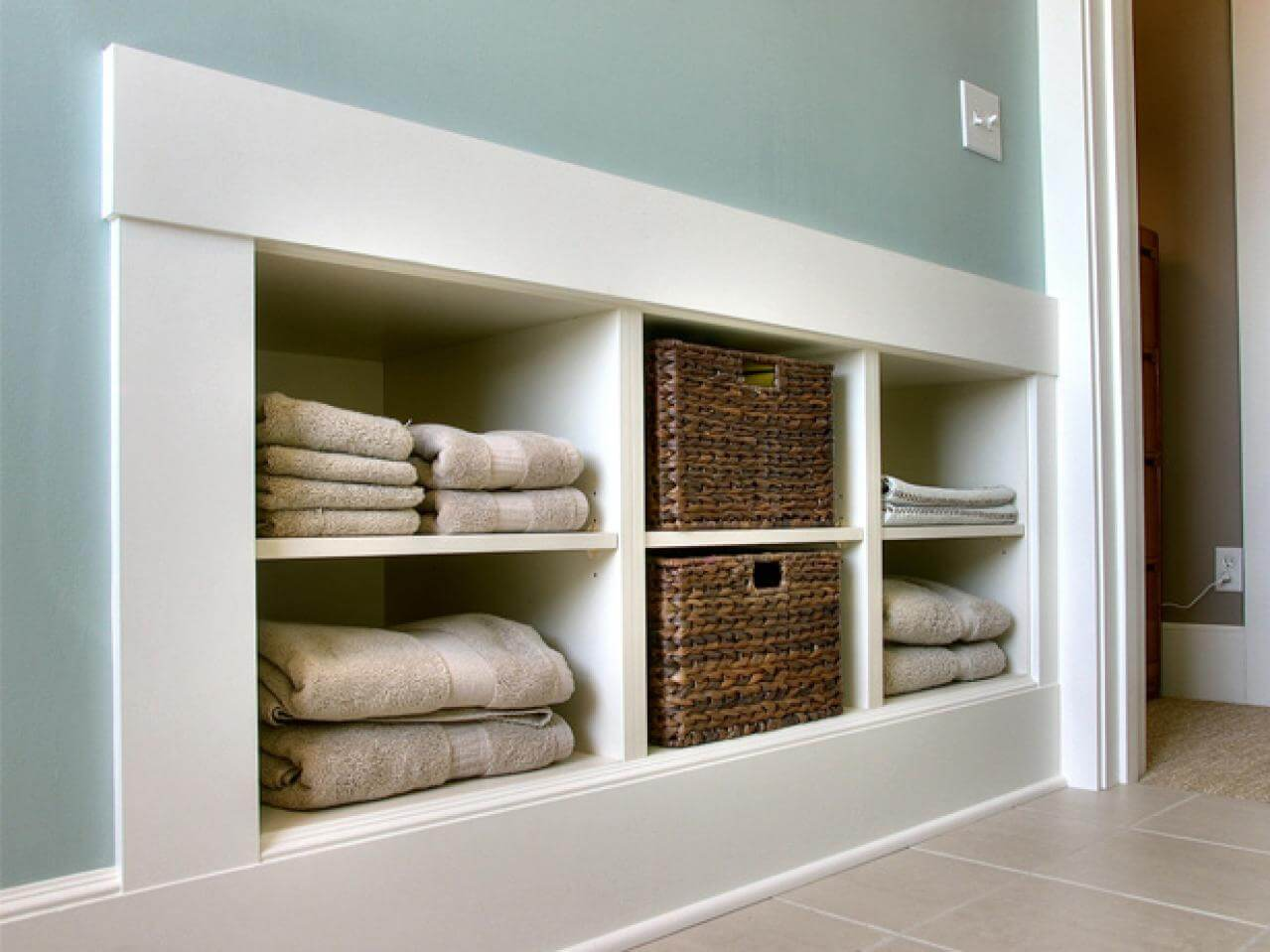 Built in bathroom storage - Built Ins And Baskets For Pretty Bathroom Storage