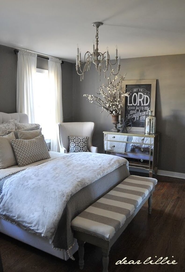 A Rustic Interplay Of Sheer White, Delicate Grey, And Weathered Wood Bedroom