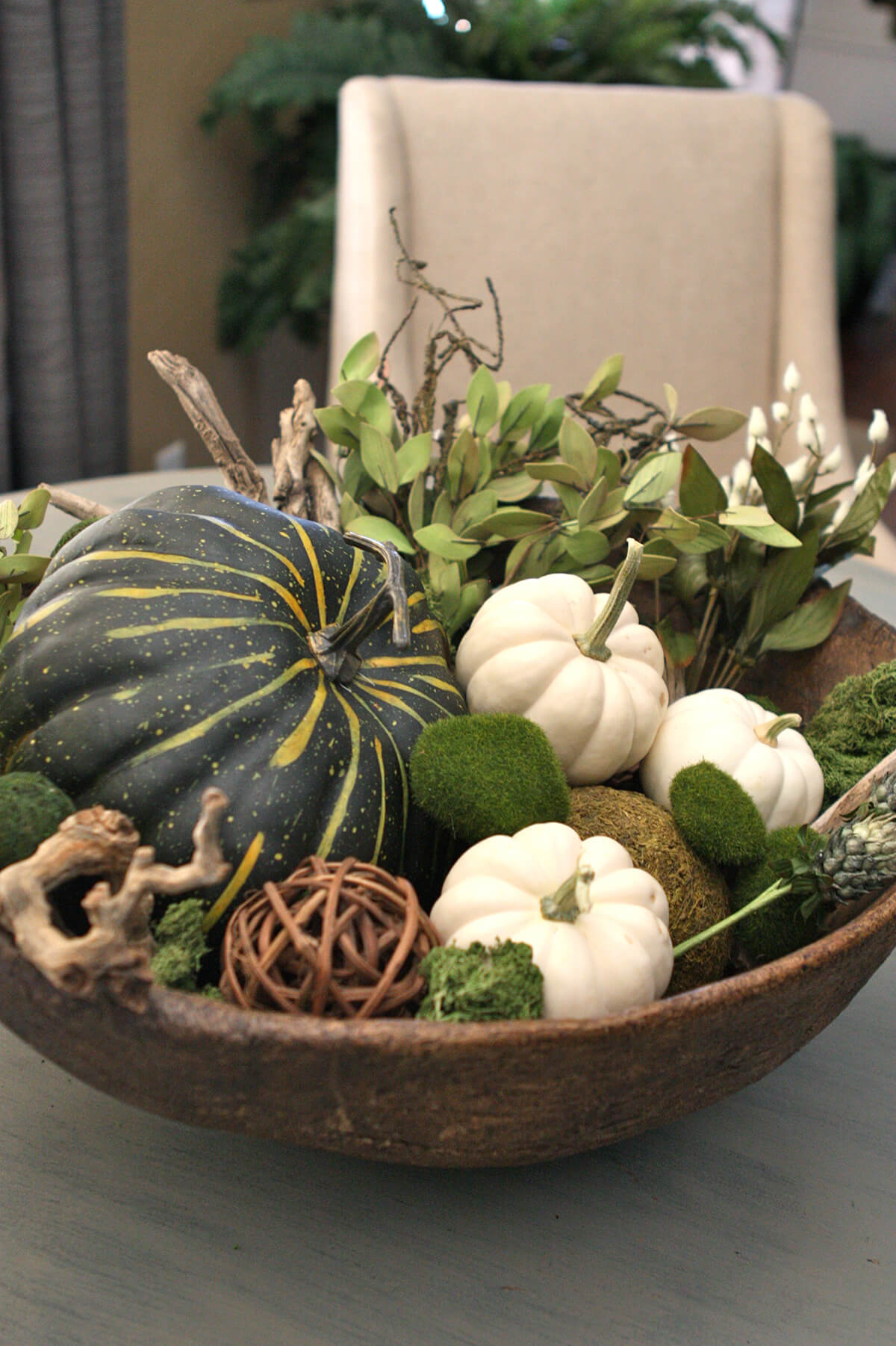 Pumpkins Plus Rustic Elements Make Unique Centerpiece