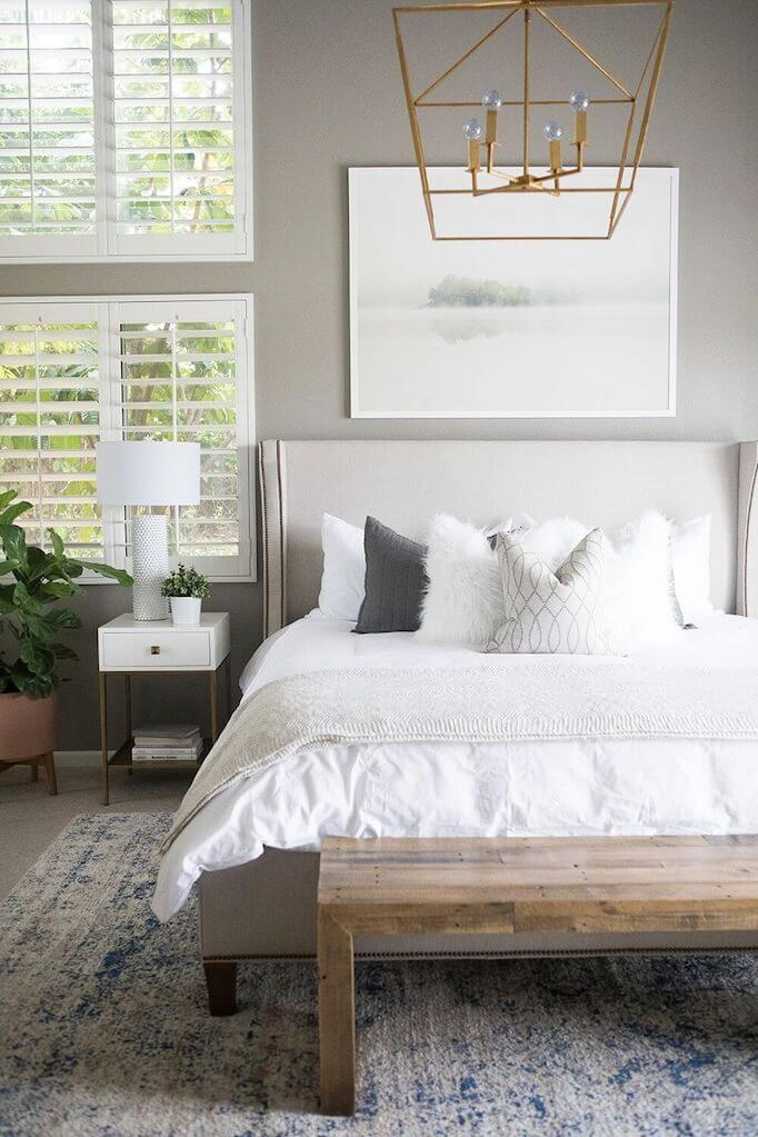 Deconstructed Chic Meets Soft Linens On A Minimalist Grey Bedroom