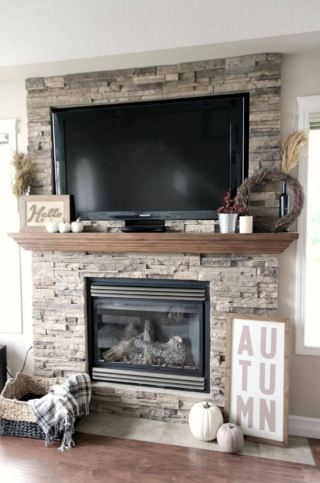 A Simple Field Stone Fireplace And Mantle