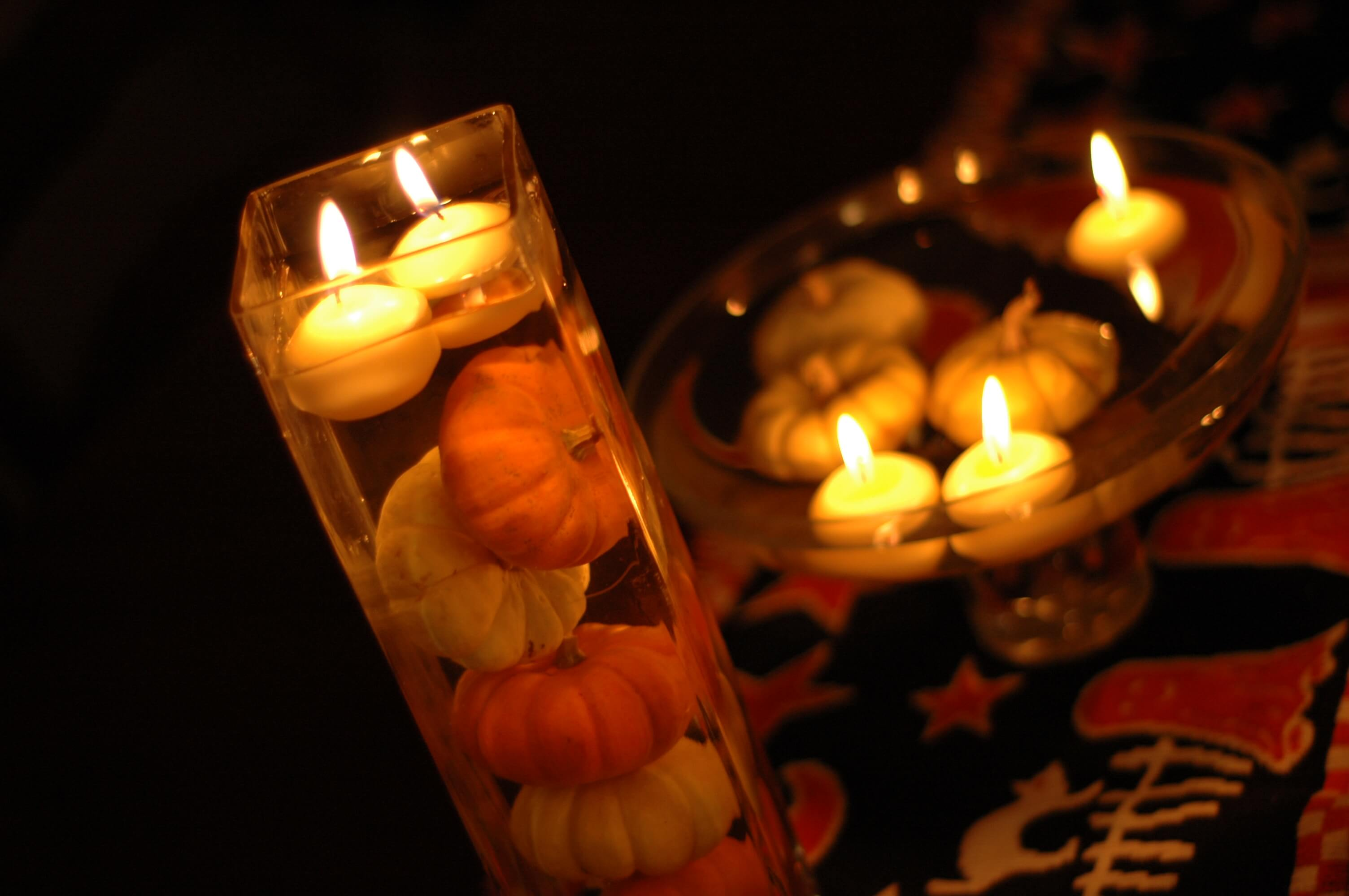 Candles Floating Amidst and Above the Pumpkins