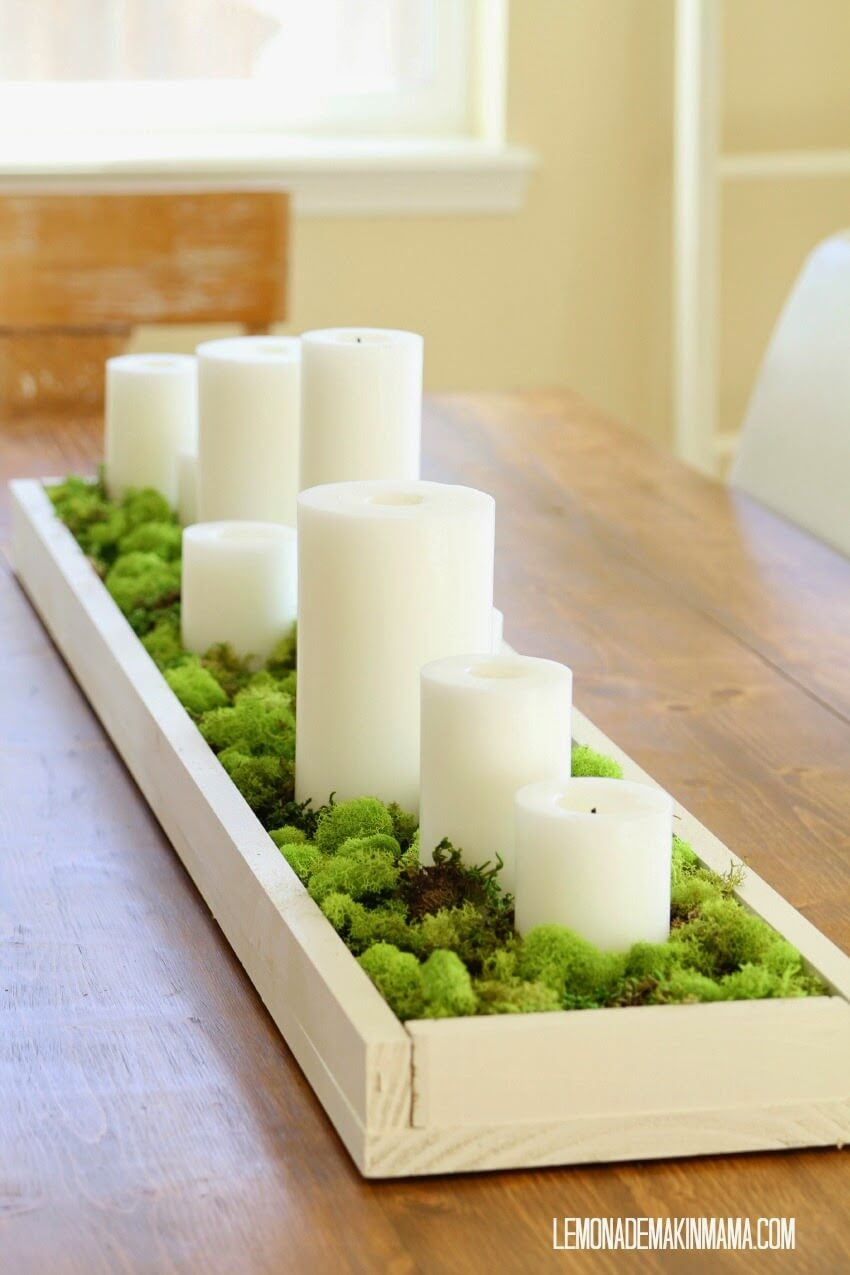 White Candles and Green Ferns Centerpiece