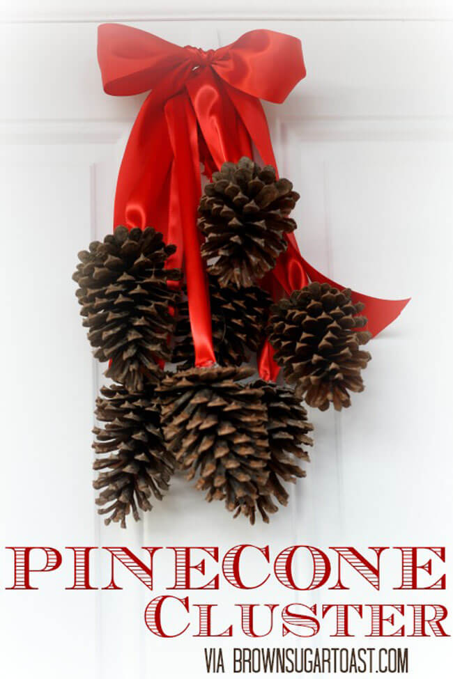 Bunch Of Pinecones Beribboned In Red