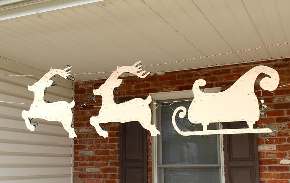 Lighted Cut Out Reindeer and Sleigh