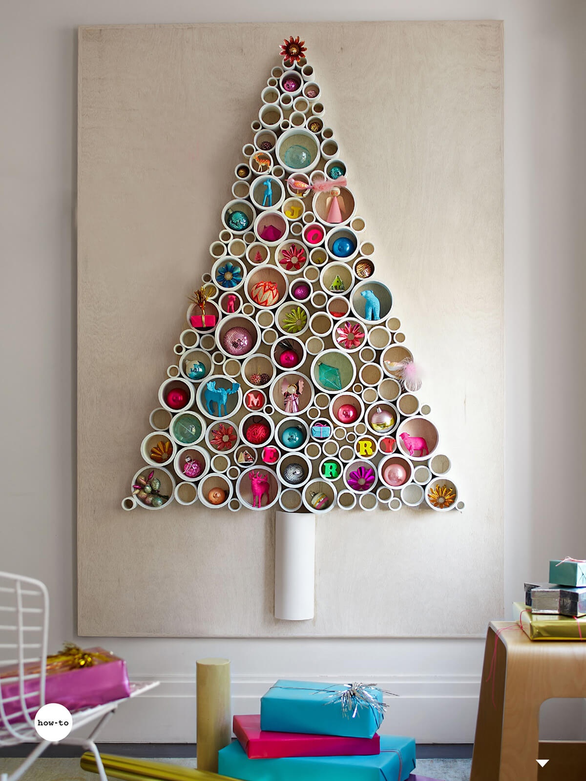 colorful pipe christmas tree on the wall