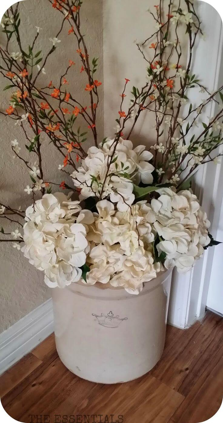 Rustic Jug with Hydrangea and Vine Arrangement
