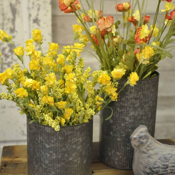Yellow and Orange Flowers in Metal Cans
