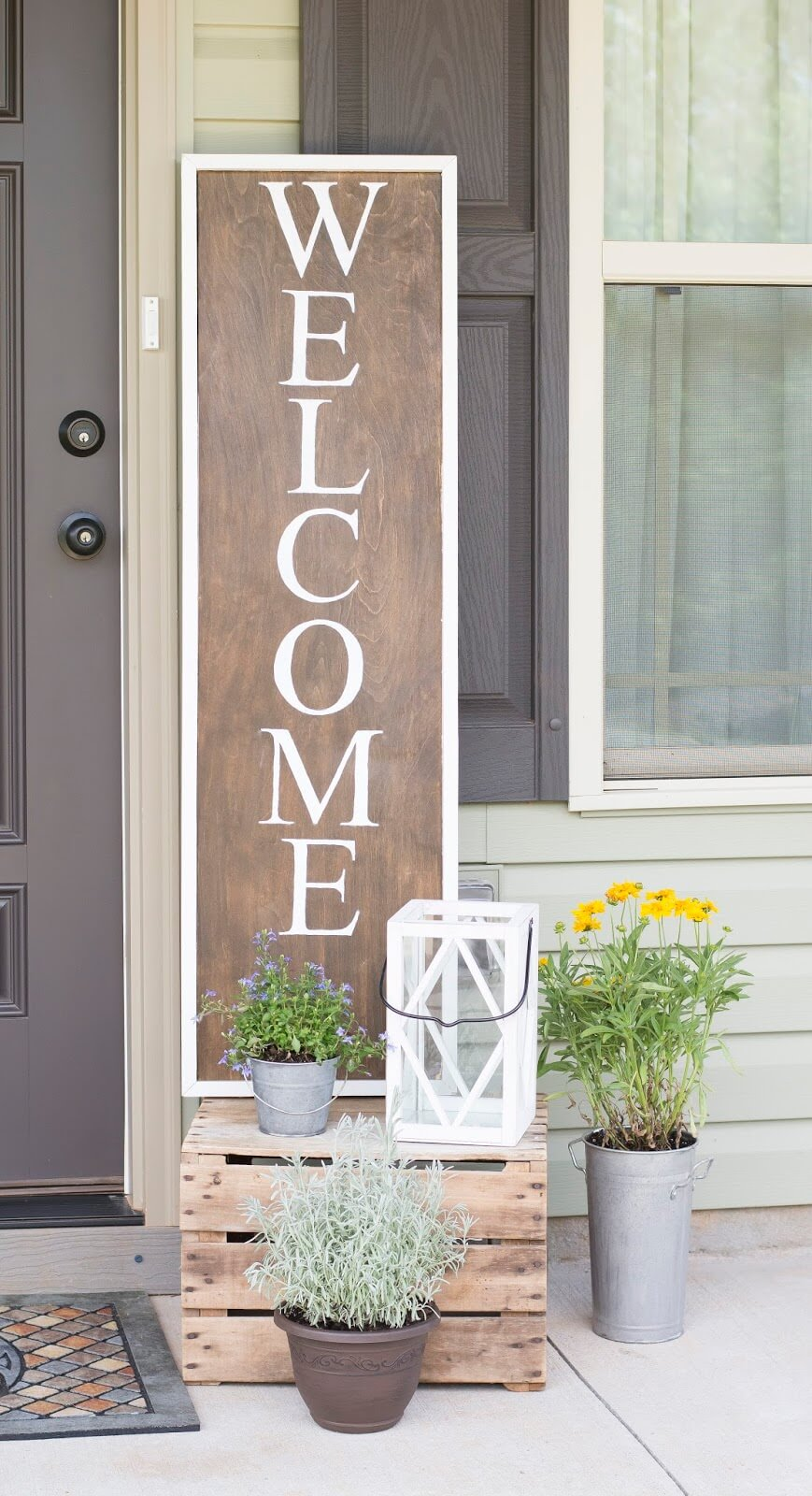 Wooden Welcome Sign And Metal Potted Plants