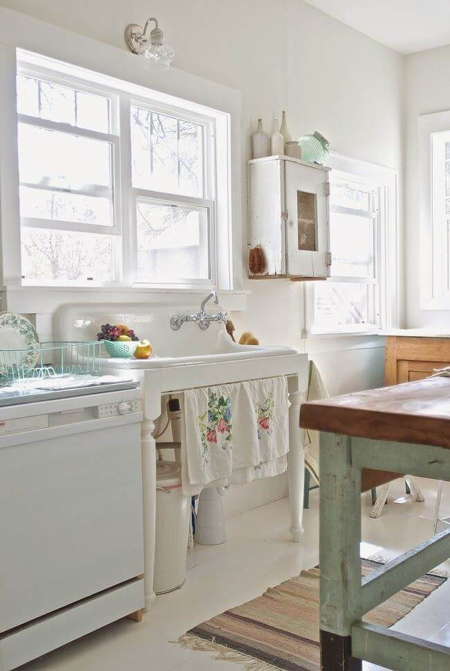 Antique Porcelain Sink and Distressed Wood Cupboard