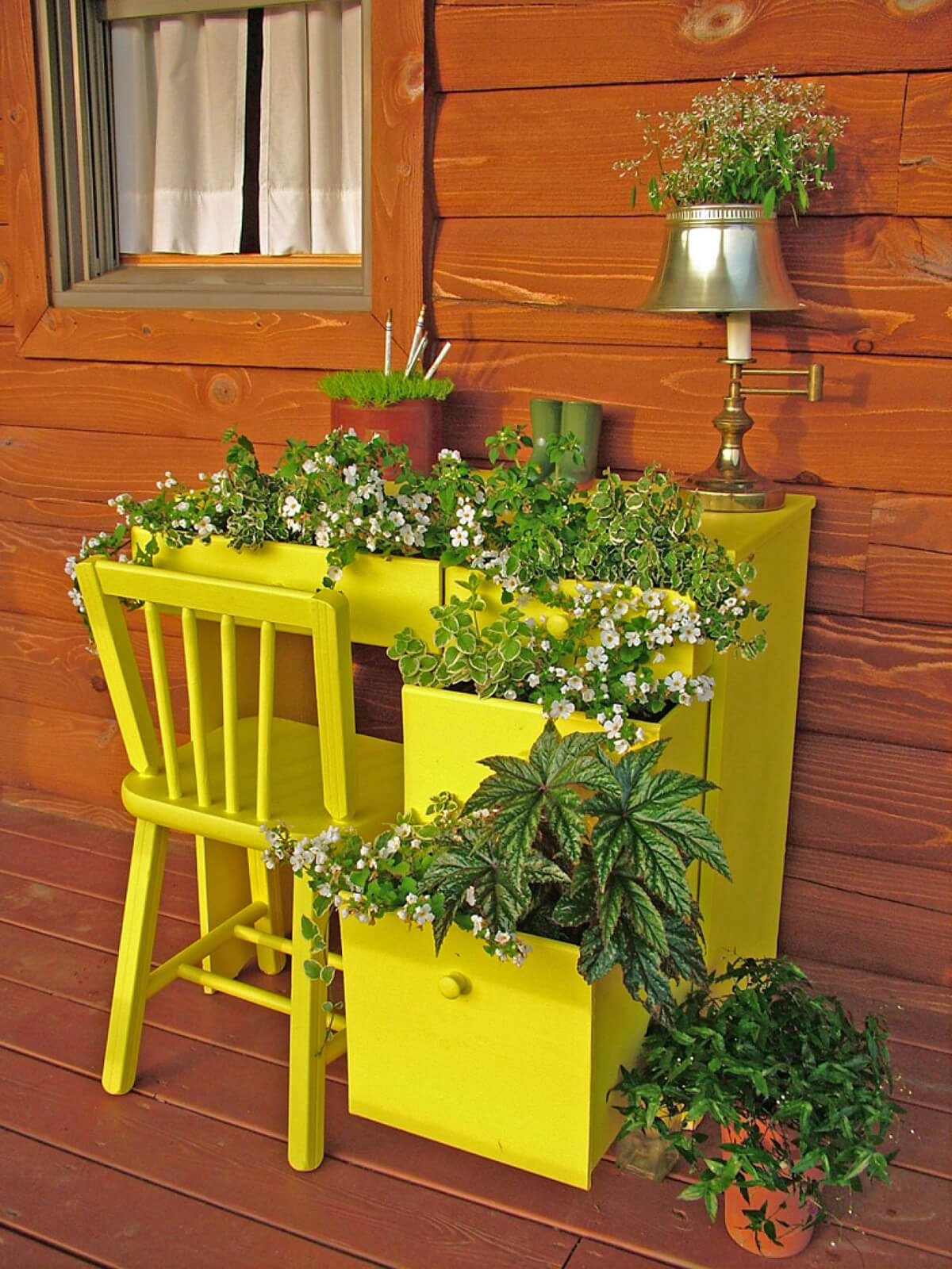 Bright Yellow Desk with Greens and Flowers