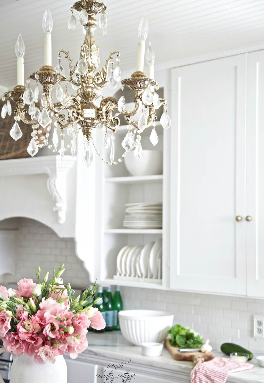 Silver and Crystal Chandelier with Wooden Cabinets