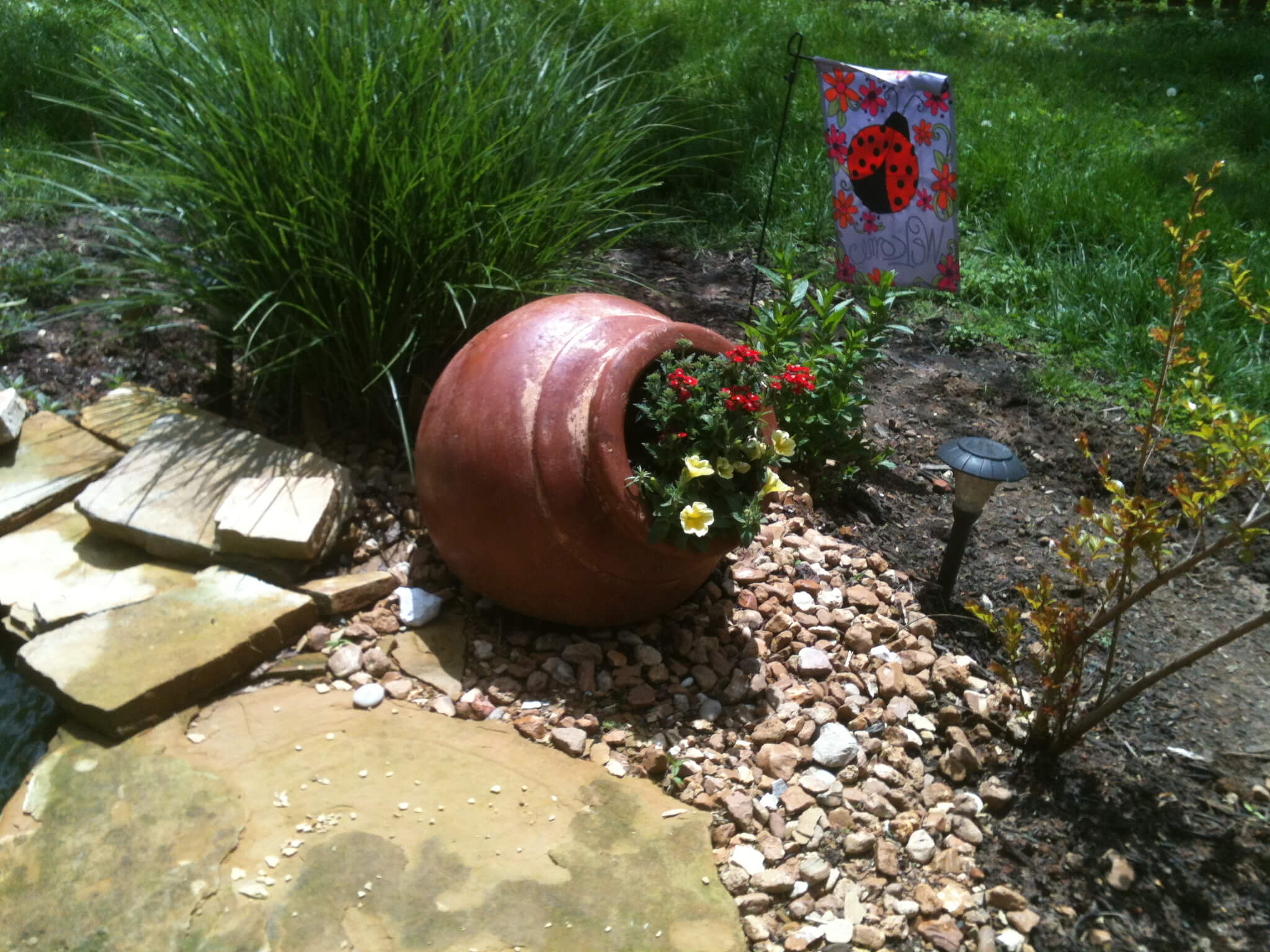 Tipped Pot with Bright Flowers