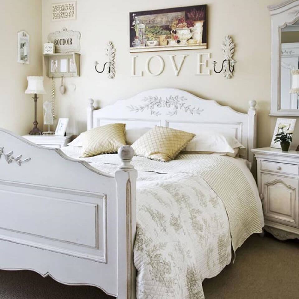 White Flowered Headboard and Wooden Letters