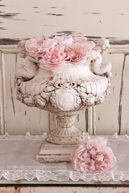 Old Pedestal Planter with Pink Blossoms