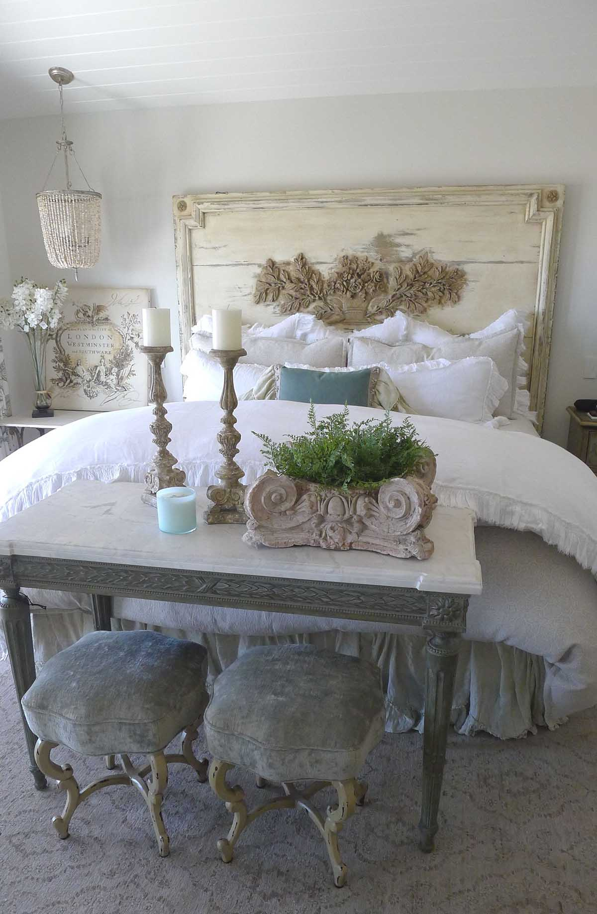 Ornamented Off-White Headboard with Luxurious Linens