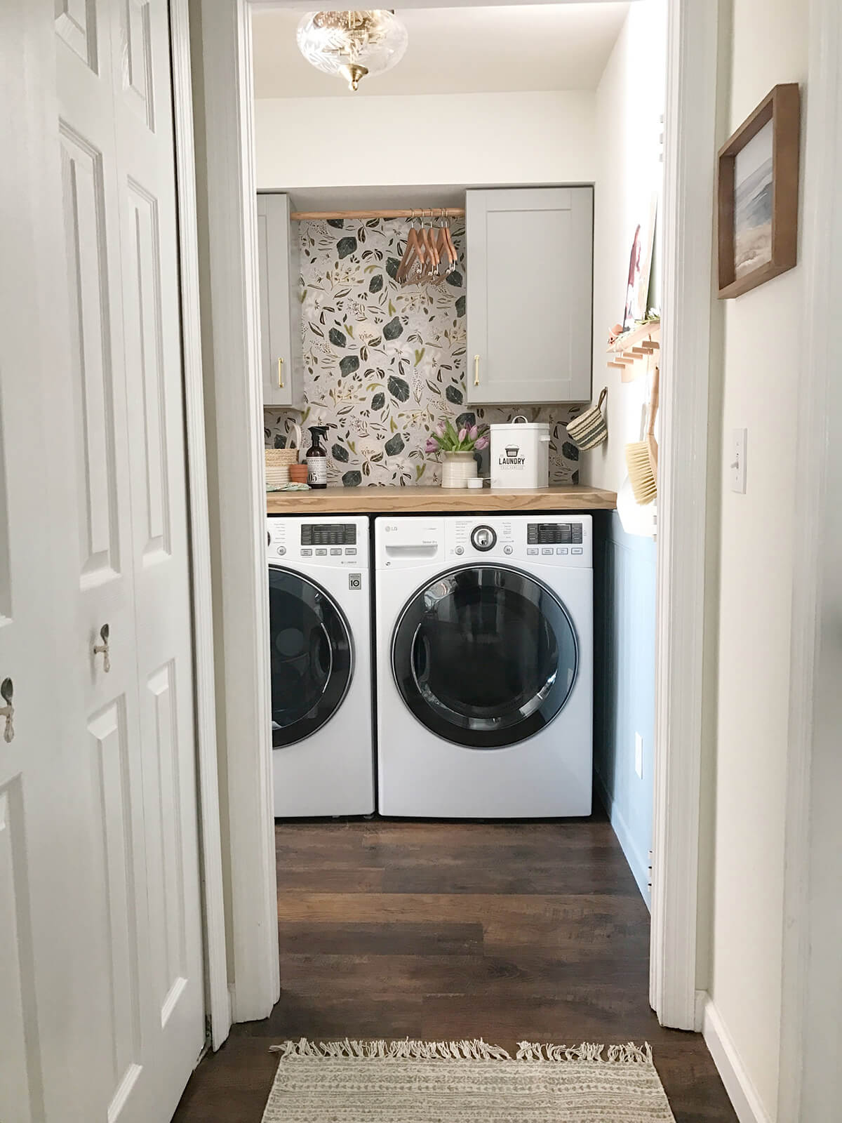 Wallpaper and Gorgeous Lighting Laundry Nook
