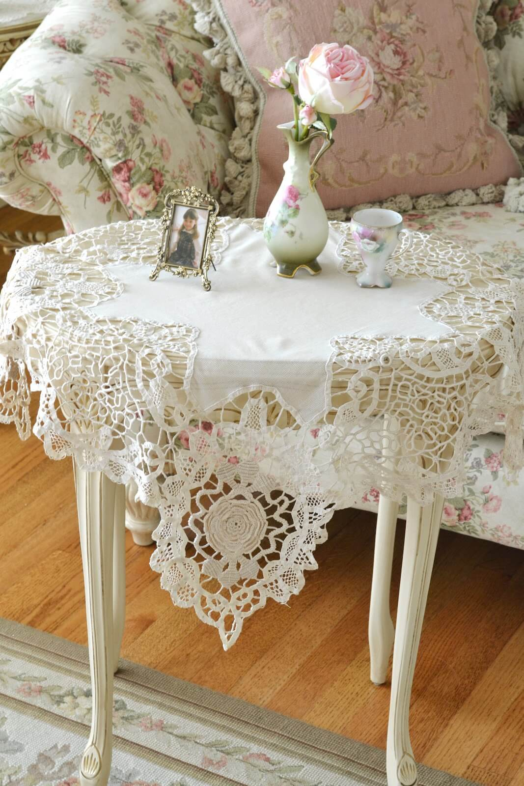 White Cutwork Doilies with Bud Vase