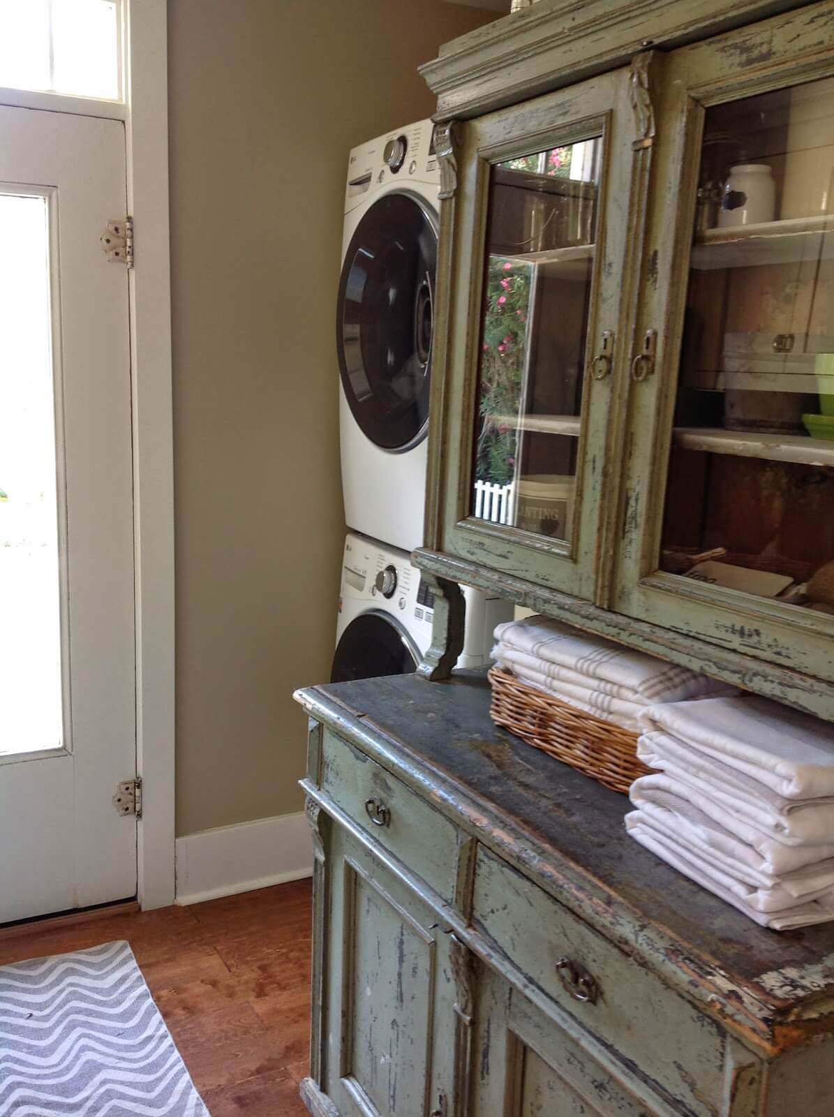 Repurposed Dining Hutch Turned Laundry Cabinet