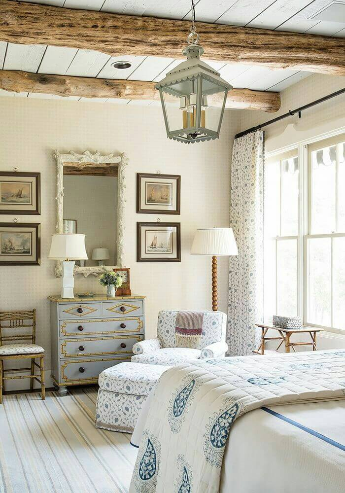 Delicate Blue and White Upholstery and Exposed Beams