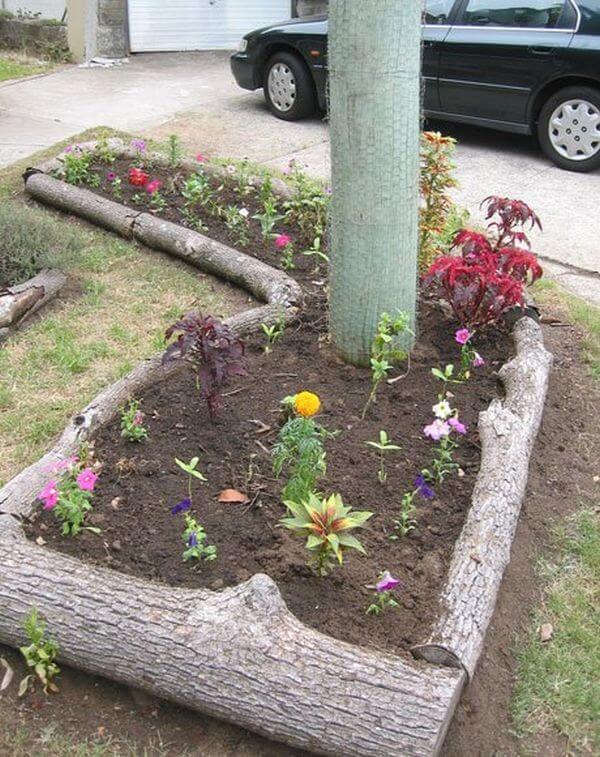 Natural Logs Around Raised Flower Bed