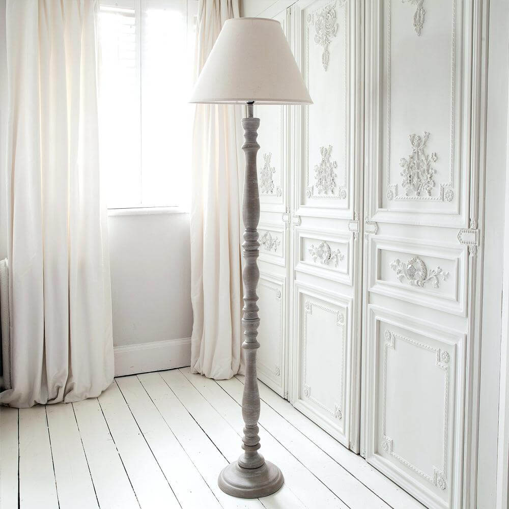 Graceful Pedestal Lamp in a White Room