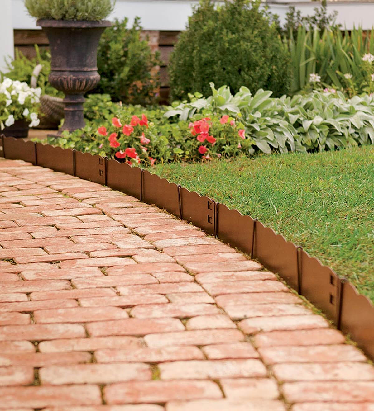 Short Scalloped Copper Edge Along Brick Path