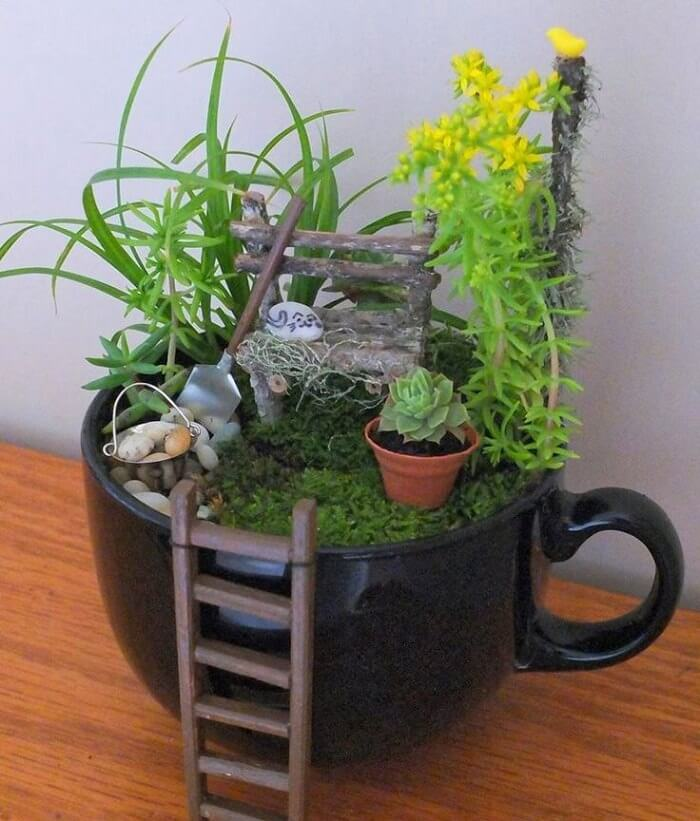 Mug with Gardening Tools, Cat, and Bench